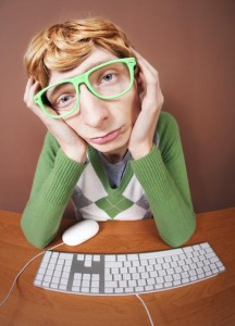 Sad nerdy guy at the computer